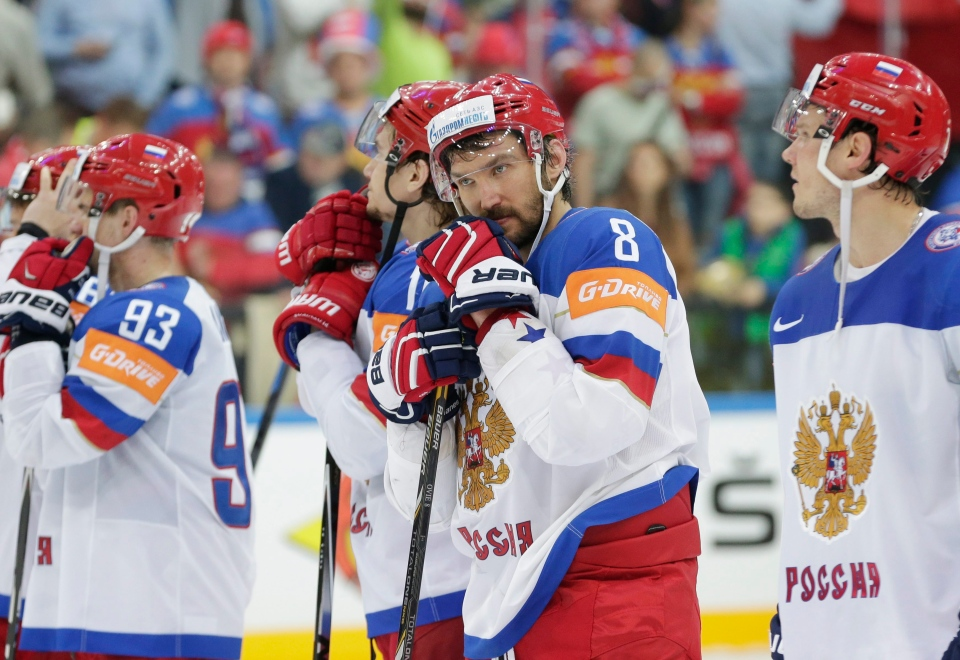 Russia's Alexander Ovechkin, second from right, stands during the medals ceremony after his team was defeated by Canada in the Hockey World Championships gold medal match in Prague, Czech Republic on Sunday, May 17, 2015. (AP / Petr David Josek)