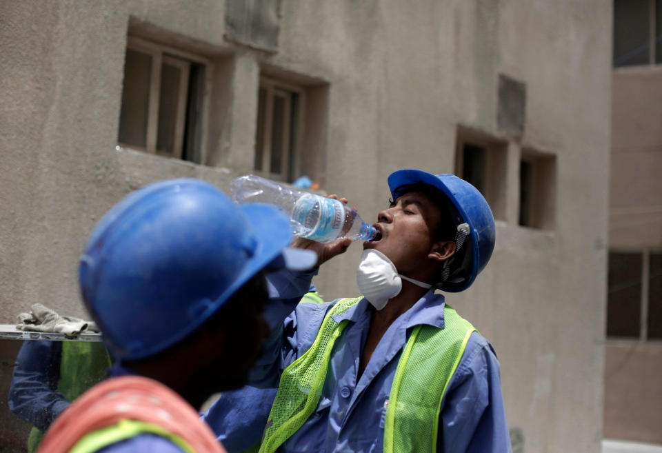 A worker takes a sip of water in Doha, Qatar in this May 3, 2015 file photo. (AP / Maya Alleruzzo)