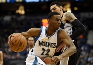 In this Jan. 10, 2015, file photo, Minnesota Timberwolves forward Andrew Wiggins (22) drives against San Antonio Spurs guard Danny Green (14) during the fourth quarter of an NBA basketball game in Minneapolis. (AP / Hannah Foslien)