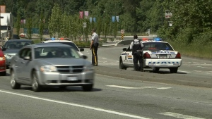 Police scan roadways for any sign of a suspect who allegedly pointed a gun at an officer in New Westminster. May 18, 2015. (CTV Vancouver)