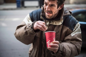 Joe Sallai, 45, panhandles on the corner of College and Yonge in Toronto on Friday, March 20 2015.(Vincent Elkaim/THE CANADIAN PRESS)