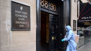 A police forensics officer enters the Hatton Garden Safe Deposit company in London Tuesday May 7, 2015.  (AP / Dominic Lipinski)
