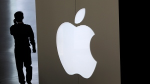 In this Sept. 5, 2014 file photo, a man walks into an Apple store in Beijing. (AP / Andy Wong, File)