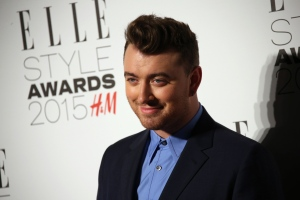 Sam Smith poses for photographers upon arrival at the Elle Style Awards in London on In Feb. 24, 2015. (Invision / Joel Ryan)