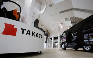 The Takata Corp. logo is displayed at a Toyota Motor Corp.'s showroom in Tokyo on Nov. 6, 2014. (AP / Shizuo Kambayashi)