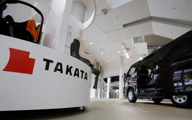 The Takata Corp. logo is displayed at a Toyota Motor Corp.'s showroom in Tokyo on Nov. 6, 2014. (AP / Shizuo Kambayashi)