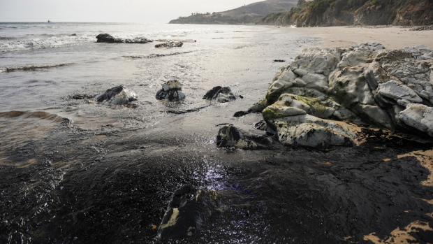 An oil slick washes up on the shore near Goleta, Calif., Tuesday, May 19, 2015. (Kennth Song / The News-Press)