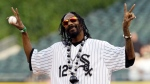 Rapper Snoop Dogg gestures before throwing out a ceremonial first pitch before a baseball game between the Minnesota Twins and the Chicago White Sox in Chicago, Thursday, May 24, 2012. (AP / Nam Y. Huh, File)