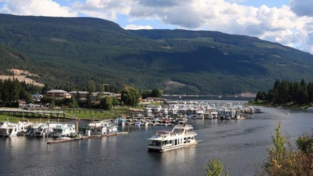 A houseboat cruises in B.C.