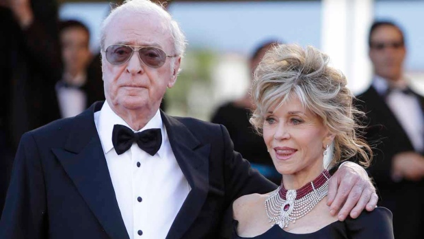 Actors Michael Caine, left, and Jane Fonda pose for photographers as they arrive for the screening of the film Youth at the 68th International Film Festival, Cannes, southern France, Wednesday, May 20, 2015. (AP / Lionel Cironneau)