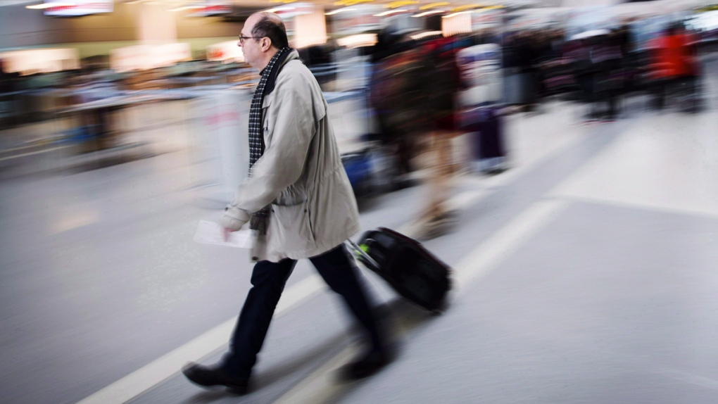 A man carries his luggage at Pearson Airport