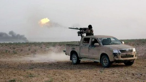 In this picture released on Wednesday, May 20, 2015 by the website of Islamic State militants, an Islamic State fighter fires his weapon during a battle against the Syrian government forces on a road between Homs and Palmyra, Syria. (The website of Islamic State militants)