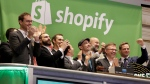 Shopify CEO Tobias Lutke, center wearing hat, is celebrated as he rings the New York Stock Exchange opening bell, marking the Canadian company's IPO, Thursday, May 21, 2015. (AP / Richard Drew)