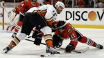 Anaheim Ducks centre Ryan Getzlaf and Chicago Blackhawks centre Andrew Desjardins vie for the puck during the first period of Game 3 of the Western Conference finals in the NHL hockey Stanley Cup playoffs in Chicago on May 21, 2015. (AP / Nam Y. Huh)