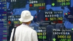 A man look at an electronic stock indicator of a securities firm in Tokyo, Thursday, May 21, 2015. (AP / Shizuo Kambayashi)