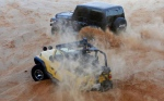 In a weekly escape from the violence gripping their country, young Libyans converge each Friday to race on the sand dunes in their four-wheel drive vehicles in Qarabuli on the Mediterranean coast, 60 kilometres east of the capital Tripoli. (AFP / Mahmud Turkia)
