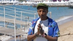 Pharrell Williams poses for photographers during a photo call for the film Dope, at the 68th International Film Festival, Cannes, southern France, Friday, May 22, 2015. (Joel Ryan / Invision)