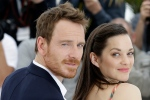 Actors Michael Fassbender, left, and Marion Cotillard pose for photographers during a photo call for the film 'Macbeth,' at the 68th international film festival, Cannes, southern France, Saturday, May 23, 2015. (AP / Lionel Cironneau)