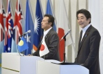 Japanese Prime Minister Shinzo Abe, right, accompanied by Palau's President Tommy Remengesau, speaks following the 7th Pacific Islands Leaders Meeting in Iwaki, Fukushima Prefecture, northeastern Japan Saturday, May 23, 2015. (Shigeyuki Inakuma / Kyodo News via AP)