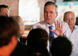 Former Florida Gov. Jeb Bush answers questions as he speaks to a morning crowd at the Draft restaurant, Thursday, May 21, 2015, in Concord, N.H. Veterans of the Iraq War watched in frustration as Republican presidential contenders, including Bush, distanced themselves in recent days from the decision their party enthusiastically supported to invade Iraq. (AP/Jim Cole)