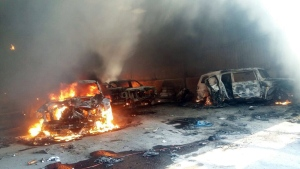 Vehicles burn, in a warehouse after a gun battle at Rancho del Sol, near Ecuanduero, in western Mexico, Friday, May 22, 2015. (AP / Oscar Pantoja Segundo)