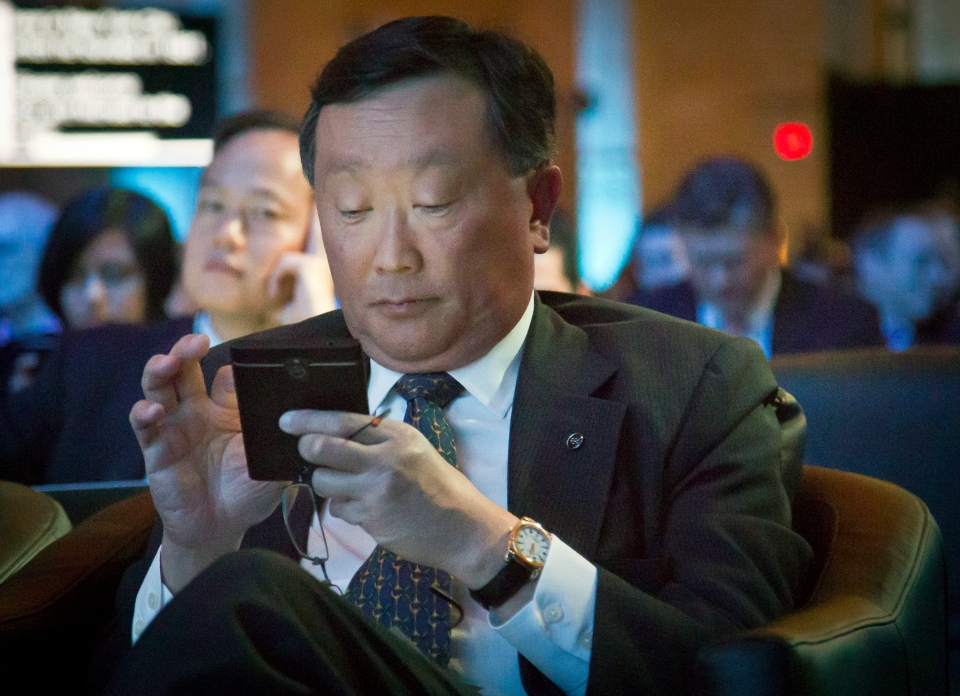 BlackBerry CEO John Chen interacts with his phone during a presentation of the company's new phone, the BlackBerry Classic, Wednesday, Dec. 17, 2014, in New York. (AP / Bebeto Matthews)