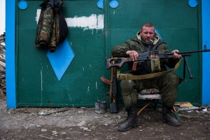 In this Thursday March 12, 2015 file photo, a pro-Russian rebel rests at the frontline in a village not far from Luhasnk, eastern Ukraine. (Mstyslav Chernov / AP Photo)