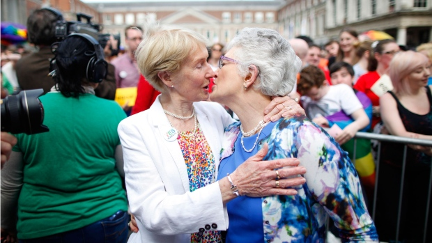 Irish Senator Katherine Zappone, right, and partner Ann Louise Gilligan celebrate as the first results in the Irish referendum start to filter through at Dublin Castle, Ireland, Saturday, May 23, 2015. (AP / Peter Morrison)