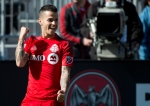 Toronto FC forward Sebastian Giovinco reacts after scoring on the Portland Timbers during first half MLS soccer action in Toronto on May 23, 2015. (Nathan Denette / The Canadian Press)