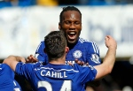Chelsea's Didier Drogba embraces Gary Cahill as they celebrate after the English Premier League soccer match between Chelsea and Crystal Palace at Stamford Bridge stadium in London, Sunday, May 3, 2015. Chelsea won the match 1-0 to secure Premier League title with 3 games to spare. (AP Photo/Alastair Grant)