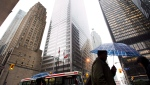 People walk in Toronto's financial district in Toronto. (Nathan Denette/THE CANADIAN PRESS)
