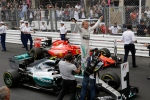Mercedes driver Nico Rosberg of Germany, center, celebrates after winning the Formula One Grand Prix, at the Monaco racetrack, in Monaco, Sunday, May 24, 2015. (AP / Luca Bruno)