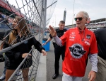 David Letterman, who ended his 33-year career as a late-night television host Wednesday, waves to fans as he walks through the pit area before the 99th running of the Indianapolis 500 auto race at Indianapolis Motor Speedway in Indianapolis, Sunday, May 24, 2015. (AP / Darron Cummings)