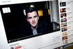 "This Wednesday, May 20, 2015 photo shows, Connor Franta's ""Coming Out"" video playing on YouTube displayed on a computer screen in Los Angeles. YouTube, which is celebrating its 10th anniversary throughout May, has in recent years propped up YouTubers like Franta - ""creators,"" the site calls them. (AP/Richard Vogel)"