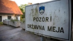 A sign reading 'Attention! National Border' is pictured on the Slovenian-Croatian border in Obrezje, Slovenia on June 18, 2013. (AFP / Jure Makovec)