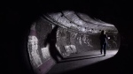 A visitor walks through a tunnel in the disused Down Street Underground station in London, England. (AFP)