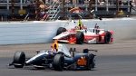 Alex Tagliani, of Canada, drives under Bryan Clauson hitting the wall in the fourth turn during the 99th running of the Indianapolis 500 auto race at Indianapolis Motor Speedway in Indianapolis, Sunday, May 24, 2015. (AP / Kirk Stierwalt)