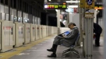 A businessman is seen napping on a bench at the Tokyo train station. (AFP / Yoshikazu Tsuno)