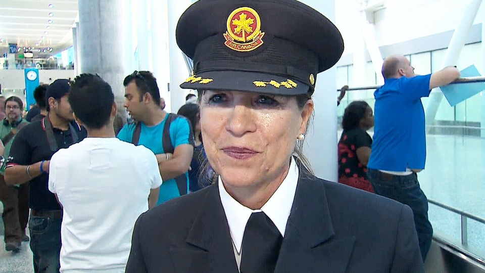 Judy Cameron speaks to reporters after her final flight as an Air Canada pilot on Sunday, May 24, 2015.