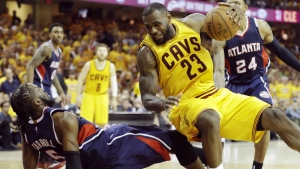 Cleveland Cavaliers' LeBron James runs over Atlanta Hawks' DeMarre Carroll during the second half in Game 3 of the Eastern Conference finals of the NBA basketball playoffs in Cleveland on May 24, 2015. (AP / Tony Dejak)