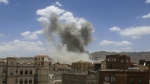Smoke rises after a Saudi-led airstrike targeted a military base in Sanaa, Yemen on May 24, 2015. (AP / Shohdi Alsofi)