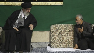 Commander of Iran's Quds Force, Qassem Soleimani, right, greets Supreme Leader Ayatollah Ali Khamenei while attending a religious ceremony in a mosque at his residence in Tehran, Iran on March 27, 2015. (Office of the Iranian Supreme Leader)