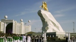 People gather for a monument unveiling ceremony in Ashgabat, Turkmenistan, on May 25, 2015. (AP / Alexander Vershinin)