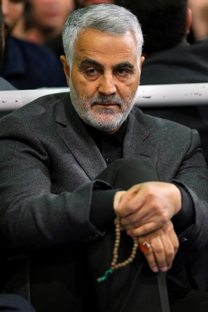 In this Friday, March 27, 2015 file photo released by an official website of the office of the Iranian supreme leader, commander of Iran's Quds Force, Qassem Soleimani, sits in a religious ceremony at a mosque in the residence of Supreme Leader Ayatollah Ali Khamenei, in Tehran, Iran. (Office of the Iranian Supreme Leader via AP)