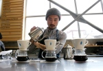 In this April 27, 2015 photo, a barista brews coffee at a Blue Bottle Coffee shop in Tokyo. (AP Photo/Shuji Kajiyama)