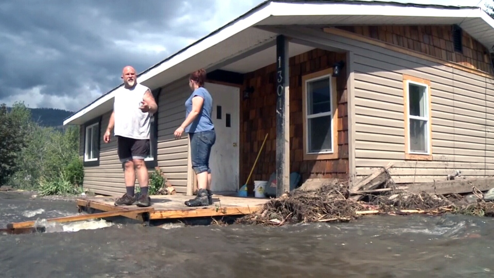 Flood waters surround a home in Cache Creek, B.C.