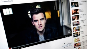"Connor Franta's ""Coming Out"" video playing on YouTube displayed on a computer screen in Los Angeles on May 20, 2015. YouTube, which is celebrating its 10th anniversary throughout May, has in recent years propped up YouTubers like Franta. (AP / Richard Vogel)"