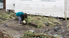 A girl helps clean up in Cache Creek