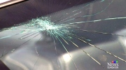 Large rock dropped on car: Terrifying moment