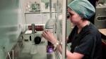 An embryologist works on embryo in London, U.K. (AP Photo/Sang Tan)